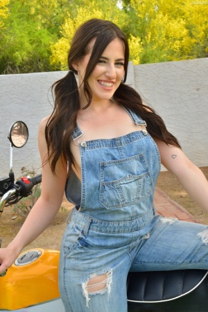 Amateur model Aubree licks a dildo on a motorbike before showcasing her pussy