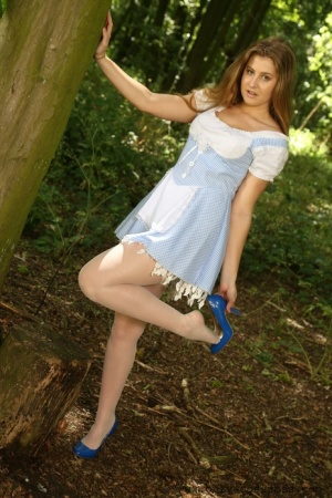 Sweet blonde Lucy Ava disrobes to white stockings  panties while in the woods