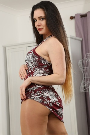 Brunette model Tommy sets her boobs free from a dress in pantyhose