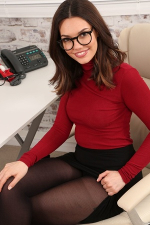 Glasses wearing secretary Abigail B exposes her tits while wearing pantyhose
