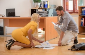 Beautiful blonde secretary Izzy Delphine has sex with a coworker on a desk