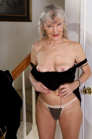 Old woman Linda Jones gives a wave after making her nude modelling debut