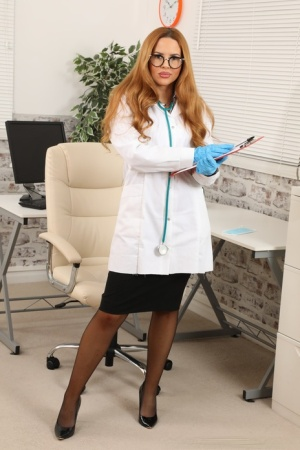 UK redhead Sera Williams releases her tits from a lab coat in her office