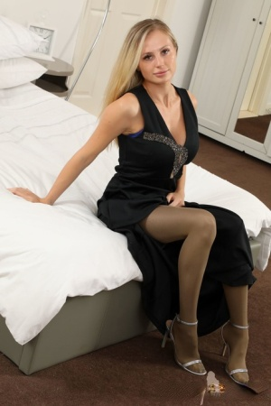 Natural blonde Cassie B looses her tits from a long gown in hose and nylons