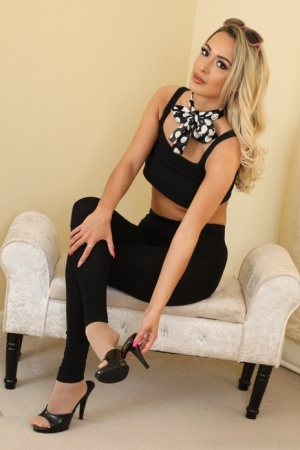 Dirty blonde Lauren Louise removes black leggings while going topless in hose