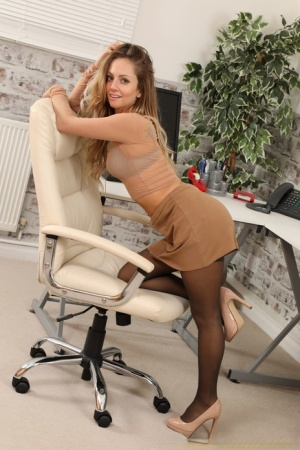Sexy secretary Suz uncups her firm tits at work in nylons and garters