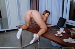 Blonde student Libby plays with a cupcake while getting naked in nylon socks