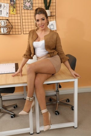 Hot secretary Tillie uncovers her natural tits while wearing pantyhose