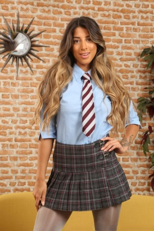 Schoolgirl Alexa takes off her skirt while wearing a blouse and pantyhose