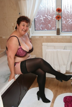 Fat older lady Kinky Carol uncovers her huge boobs after drawing a bath 99549330
