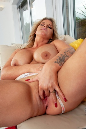 Blonde MILF Kacie Lou doffs a leather mini before showing her big tits  pussy