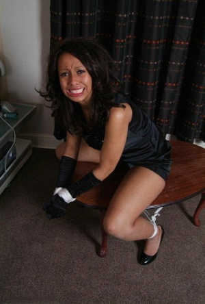 Restrained and ball gagged female exposes her upskirt underwear