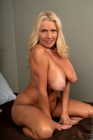 Older blonde Maddie Cross frees her big tan lined tits before showing her cunt