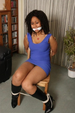 Black girl Dani is cleave gagged while hogtied in a short dress and footwear