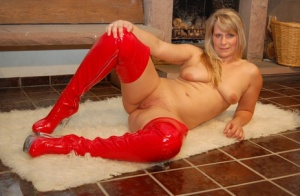 Blonde amateur Sweet Susi models totally naked in red thigh-high latex boots