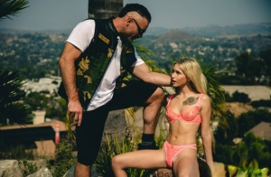 Skinny blonde Kiara Cole strips naked on a patio with a great view