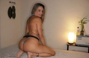 Massage attendant Karla jerks off a clients dick in a revealing swimsuit