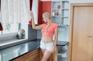 Young blonde sports braided pigtails during sex in the kitchen with her guy