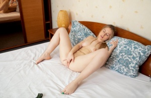 Solo girl Night Ivy fingers her smooth pussy while naked on a bed