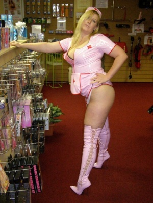 Blonde amateur Samantha works free of a latex nurse outfit in a sex shoppe