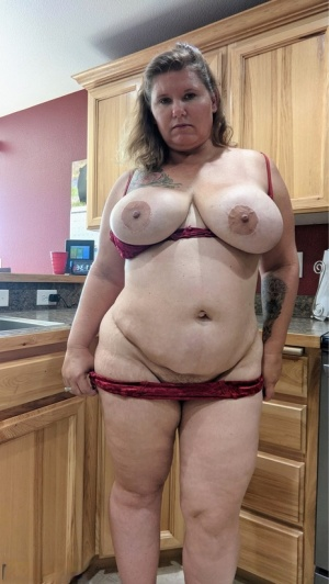 Amateur woman Busty Kris Ann shows her big tits and butt in her kitchen