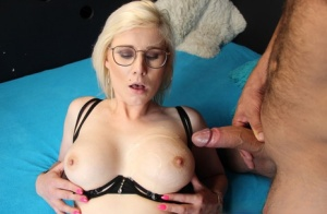 Platinum blonde takes a cumshot on her big tits after sex in nylons and heels
