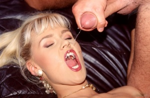 Tall blonde Anike receives open mouth cumshots after being gang banged