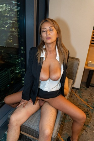 Japanese secretary has sex with her man friend in her office clothing
