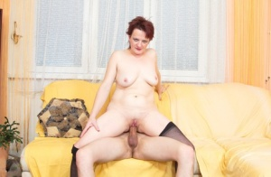 Caucasian cougar with short red hair seduces a much younger electrician