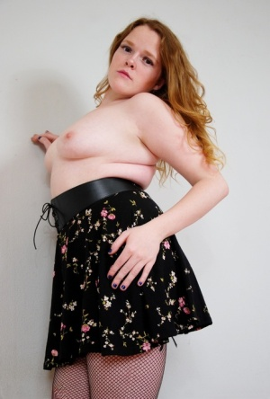 Natural redhead displays her small tits during upskirt action in mesh nylons