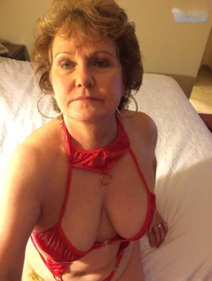Older woman Busty Bliss frees her big tits before pleasuring a penis