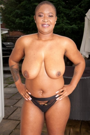 Ebony plumper Bria Marcer displays her natural boobs while sporting short hair