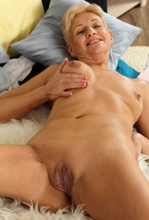 Horny older granny Scarlett J gets naked to fondle saggy tits  spread legs