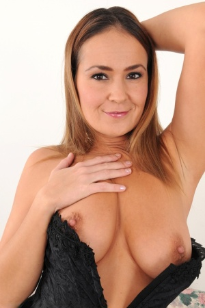 Hot 30 plus MILF Elexis Monroe uncovers nice tits before showing trimmed pussy