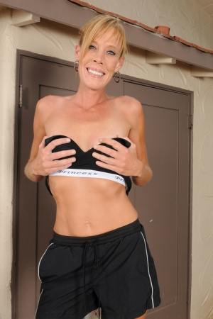 Sporty mature mom Stacey Y reveals tiny tits  small shaved pussy on treadmill