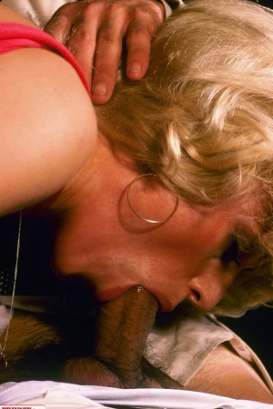 Classy blonde dresses as cleaning staff to seduces her boss in a red dress