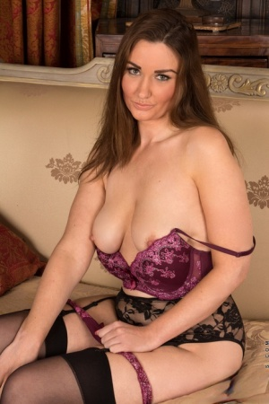 Aged housewife stripping down to stockings and lingerie before baring tits