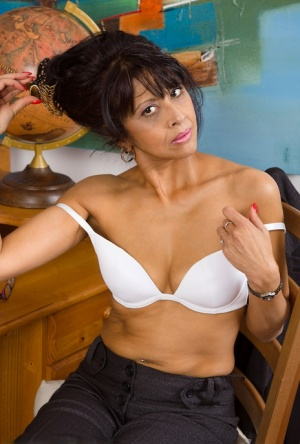 Mature teacher Sophia Smith plays with her pussy after disrobing in classroom