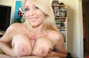 Blonde cougar Charlee Chase stripes naked before jerking her stepsons cock