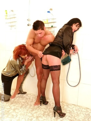 Clothed older broads walk in on naked stud in shower and do a threesome