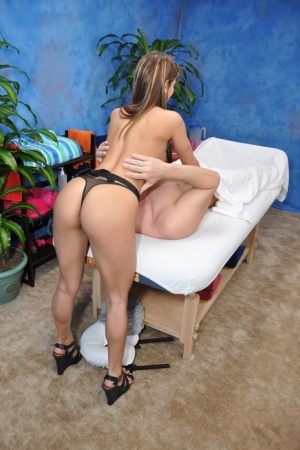 18 year old girl gives a topless massage before riding her clients penis 61725793