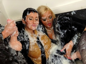 Clothed women bare their boobs while being doused in fake semen 42991727