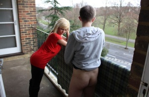 Clothed blonde chick steps onto the balcony to suck off her neighbour