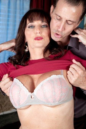 Clothed woman over 50 Ciara is undressed during foreplay and eventually banged