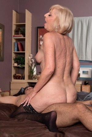 Fat granny Scarlet Andrews with pierced nipples seducing young stud for a fuck