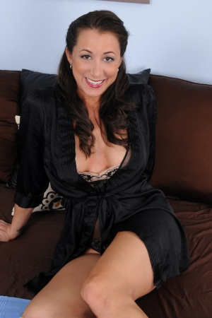 30 plus female Kaylynn crosses her legs during a close up of her tight slit