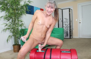 Naked granny jerks off a cock while riding on top a Sybian sex machine