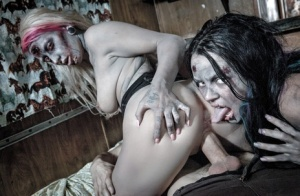Fetish models Brittany Lynn and Jessie Lee giving head in Zombie threesome