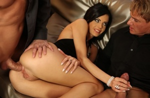 Dark haired chick gets double fucked on a leather chesterfield
