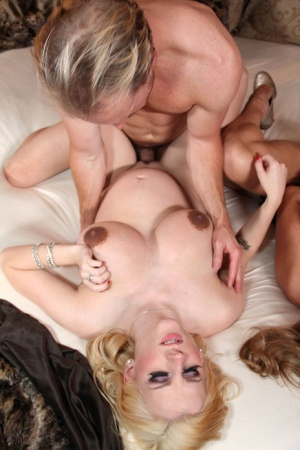 Pregnant MILF with huge dark nipples enjoys facesitting and tit fucking 3some